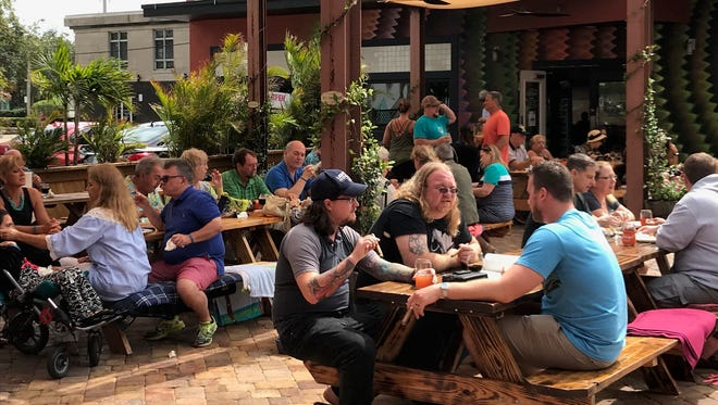 After waiting out an April shower, the sun came out and guests enjoyed seafood and beer at a recent Suzy's (Not So) Secret Supper at Intracoastal Brewing Co. in Melbourne.