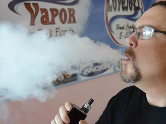 vaping with an e-cigarette
