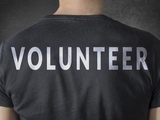 Volunteer tittle on black t-shirt. Back view.