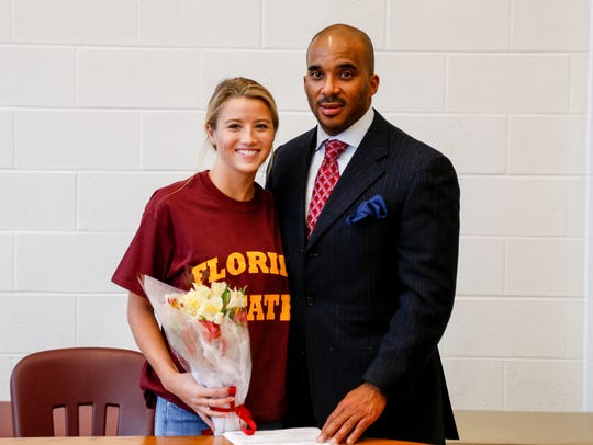 Florida State diving-commit Ayla Bonniwell stands with