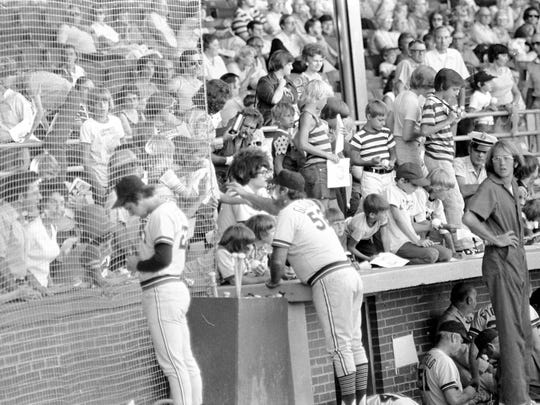 Evansville Triplets players sign autographs  for the crowd in 1977. Gregory T. Smith