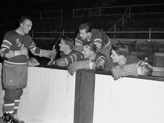 New York Rangers chat during a practice session at