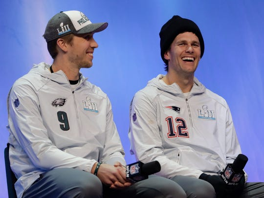 The challenger and the champ: Philadelphia Eagles' Nick Foles and New England Patriots' Tom Brady answer questions during NFL football Super Bowl 52 Opening Night Monday, Jan. 29, 2018, at the Xcel Center in St. Paul, Minn. (