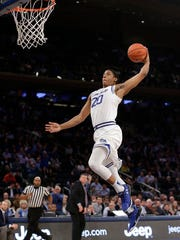 Seton Hall forward Desi Rodriguez (20) goes up to dunk against Creighton in the Big East Tournament.
