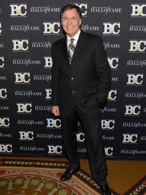 FILE - In this Oct. 20, 2014, file photo, co-host Bob Costas attends the 24th Annual Broadcasting and Cable Hall of Fame Awards at the Waldorf-Astoria in New York. Costas is stepping down as NBC's prime-time host for the Olympics, to be replaced by Mike Tirico next winter in South Korea, the network said Thursday, Feb. 9, 2017.