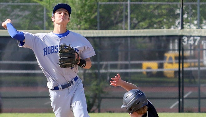 Horseheads shortstop Nico Limoncelli throws to first to complete a double play against Corning last season.