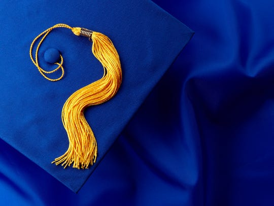 Blue mortarboard and yellow tassel.