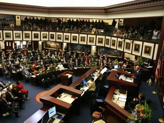Florida Gov. Rick Scott, right, delivers his State of the State address to a joint session of the Florida legislature Tuesday, Jan. 10, 2012 in Tallahassee, Fla. (AP Photo/Tampa Bay Times, Scott Keeler)