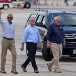 President Barack Obama, accompanied by Louisiana Gov. John Bel Edwards, center, and FEMA Administrator Craig Fugate, waves as they walk on the tarmac at the Baton Rouge Metropolitan Airport, Tuesday, Aug. 23, 2016, before boarding Air Force One after taking a tour of the flood damaged region in Baton Rouge, La. (AP Photo/Max Becherer) ORG XMIT: LAMB109