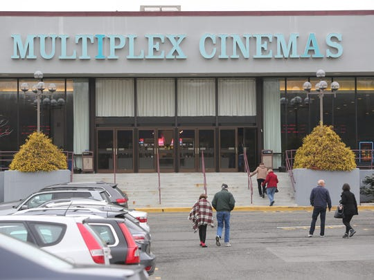Moviegoers enter the Saw Mill Multiplex Cinema in Hawthorne, Jan. 9, 2016. The theater will close Jan. 18 to make way for a new Audi dealership, but it might be months before construction work begins.