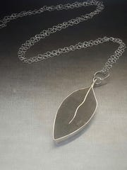 A leaf necklace made by Marjorie Bryan.