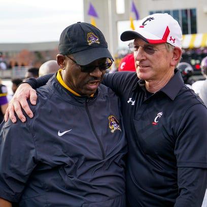 Cincinnati Bearcats head coach Tommy Tuberville hugs