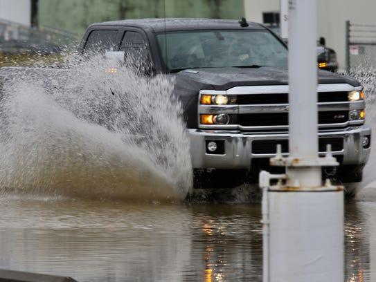 A truck drives through high water on Kellogg.