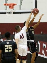 Elmira's Dan Fedor attempts to block a shot by Corning's