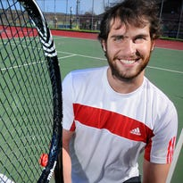 Marcelo Locatelli smiles Wednesday on the St. Cloud State University tennis courts. Locatelli is from Brazil and plays on the SCSU tennis team.