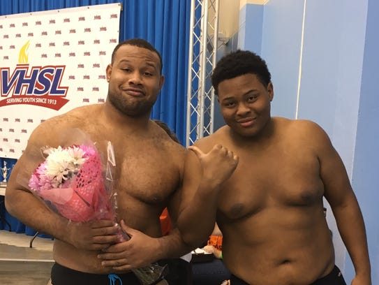 Darnell Ewell (with flowers) and his brother Denzel.