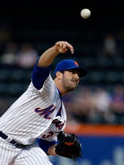 Mets starting pitcher Matt Harvey (33) delivers a pitch against the San Diego Padres in the first inning at Citi Field on Tuesday.