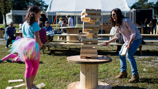 Camille Regard and her mother Olivia Regard play a game at Olympic Grove in Lafayette. The pop-up is bringing its yard games to E's Food Kitchen Roundup this weekend.