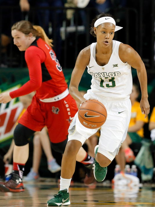 Baylor's Nina Davis (13) dribbles up court with a rebound as Texas Tech's Jamie Roe (35) gives chase during the second half of an NCAA college basketball game, Wednesday, Jan. 27, 2016, in Waco, Texas. Baylor won 69-43. (AP Photo/Tony Gutierrez)