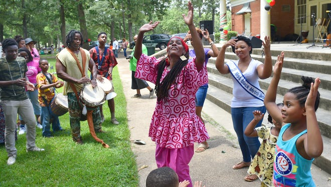 Chiquila Pearson and Jerry Jenkins, left, of Hasan Drums, lead Kuku, or a celebration dance, during Jackson?s Juneteenth celebration Saturday in Battlefield Park. Chiquila Pearson and Jerry Jenkins, left, of Hasan Drums, leads Kuku or celebration dance during Jackson's Juneteenth Celebration in Battlefield Park last year.