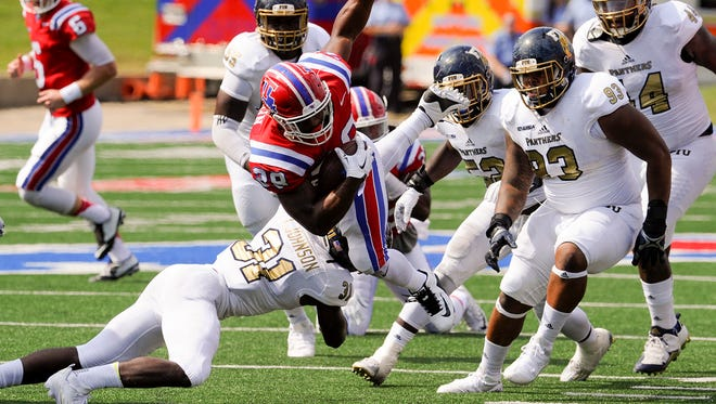 Louisiana Tech running back Kenneth Dixon missed Wednesday's practice with a new leg injury