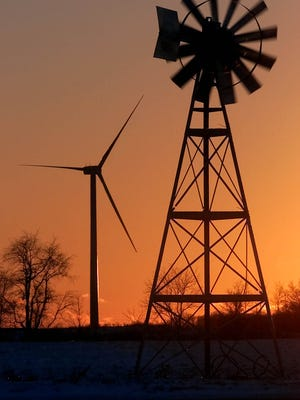 Wind power, old and new, west of Bowling Green. A new bill would freeze at current levels the amount of wind energy Ohio utilities must use.