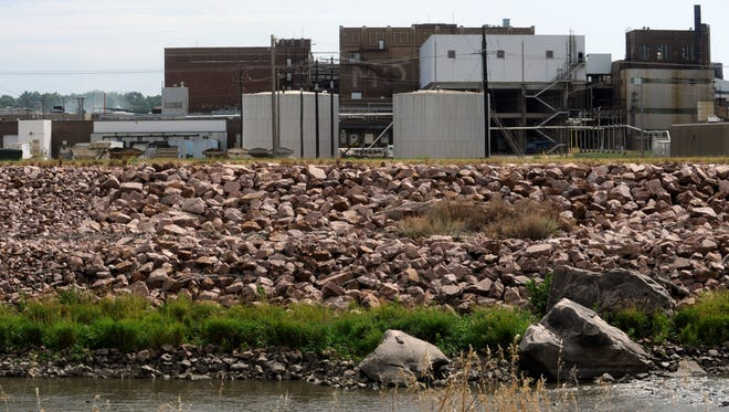 Smithfield Foods is shown in 2013 along in the Big Sioux River near downtown Sioux Falls. Growing operations such as Smithfield are operating on water quality standards set nearly two decades ago.