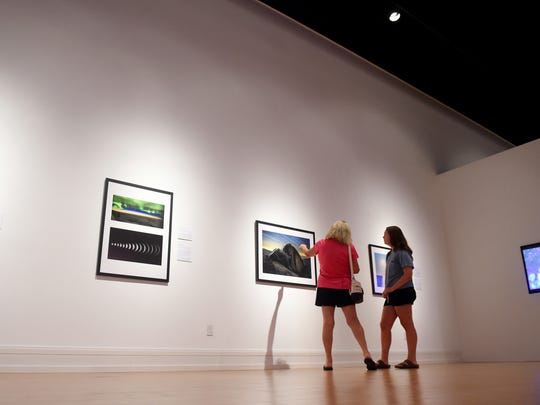 "Gayle LeGore, of Vero Beach, and her granddaughter Olivia Tibbetts, of Suffield, Conn., walk through the new Astronomy Photographer of the Year exhibit Thursday, June 28, 2018, at the Vero Beach Museum of Art. The exhibit consists of about 50 photographs of celestial spectacle chosen from entries to a photography competition by the Royal Observatory Greenwich in London. ""(Olivia) won a photography award at her school in Connecticut,"" LeGore said, ""so I wanted to wait until she came to visit before coming to the see the exhibit."" Judges for the competition looked through 3,800 entries from photographers from over 90 countries. The exhibit opened to the public May 26 and will be on display until Sept. 16."