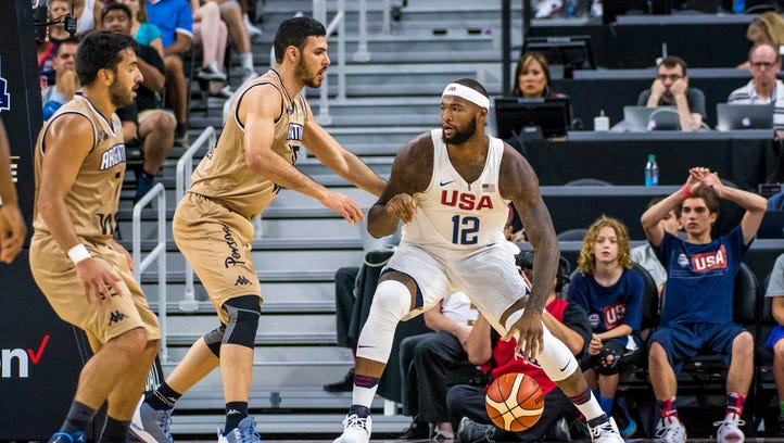 USA center DeMarcus Cousins (12) is defended by Argentina guard Facundo Campazzo (7) and center Roberto Santiago Acuna (35) during a basketball exhibition game at T-Mobile Arena in Las Vegas on Friday, July 22, 2016. USA won 111-74.