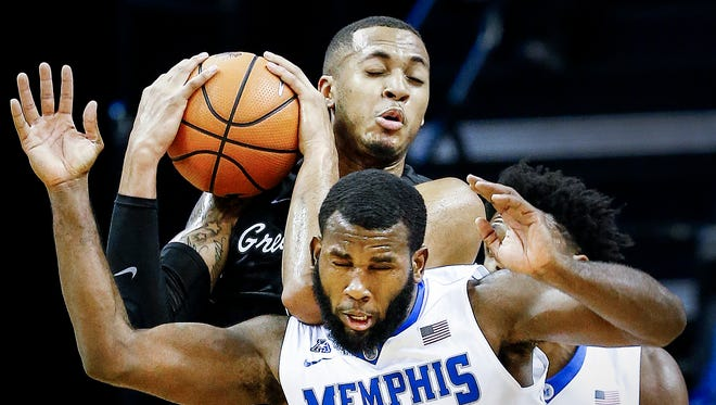 Memphis forward Raynere Thornton (front) battles Tulane guard Cameron Reynolds (back) for a loose ball during first half action at the FedExForum in Memphis Tenn., Tuesday, January 9, 2017.