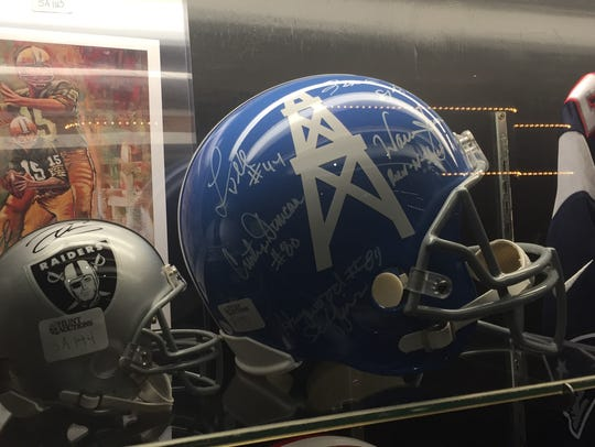 A signed Houston Oilers helmet is among the sports