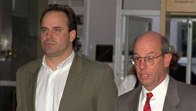 Former Ohio State and NFL quarterback Art Schlichter (left) and his attorney Frank Cremen are shown in federal court in Las Vegas in 1994, just before Schlichter pleaded guilty to bank fraud.