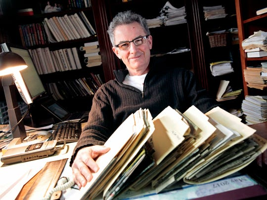 Bob McGinn sits in his home office with some of his voluminous files on the Green Bay Packers.