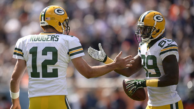 Packers quarterback Aaron Rodgers congratulates receiver James Jones after Jones scored on a a touchdown reception against the Chicago Bears.