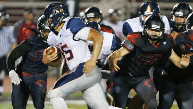 Harrison's Dawson Dahnke takes off on a 31-yard touchdown run against Lafayette Jeff Friday, September 9, 2016, at Scheumann Stadium. Harrison was up 12-0 when the game was called due to lightning with 8:01 remaining in the third quarter. The game was postponed and will resume at 11 a.m Saturday, September 10 at Scheumann Stadium.
