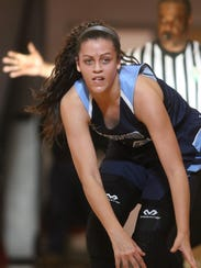 Mount Notre Dame's Gabby Marshall brings the ball up