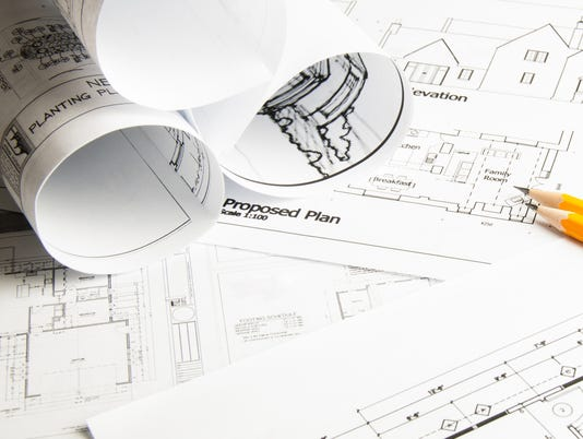 Architectural blueprints and blueprint rolls with drawing instruments