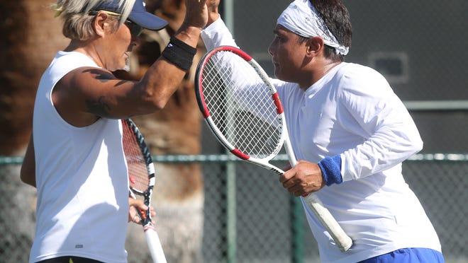 From left Stance Yamauchi and John Schaffer participate in the first ever USTA sanctioned same-sex couple competition held at the Plaza Racquet Club in Palm Springs. Tennis' governing body announced in December that husband-husband and wife-wife divisions could be added to tournaments, and this event, put on by the Desert Tennis Association and the Gay and Lesbian Tennis Association (GLTA), was the first to include such divisions.