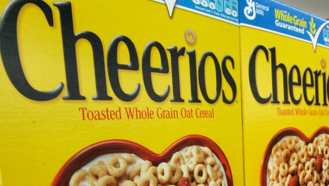 In this file photograph taken Sept. 10, 2009, boxes of General Mills Cheerios breakfast cereal varieties are displayed at a Little Rock, Ark., grocery store.