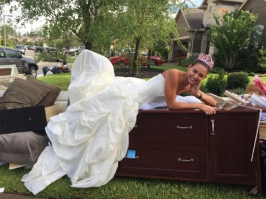 Kristy Mathoslah hams it up in her damp wedding dress,