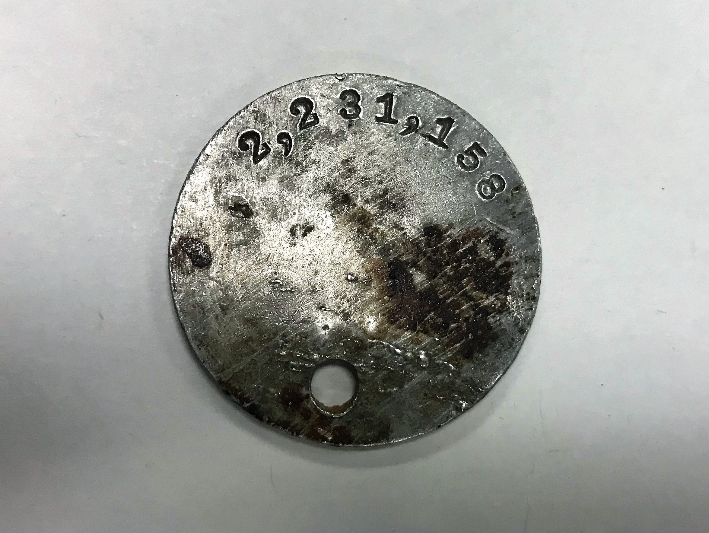 A side of Willie Tubb's World War I dog tag, showing