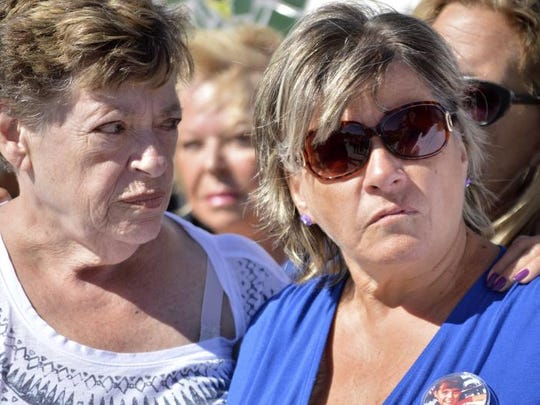 """Pat Martens, right, grandmother of Victoria Martens, is joined friends and other relatives of the 10-year-old Albuquerque girl who was brutally murdered last week during a news conference at """"A Park Above"""" in Rio Rancho, N.M. on Monday, Aug. 29, 2016. The relatives clutched each other, wept and shook their heads in disbelief while making their first public statements about Victoria Martens' death."""