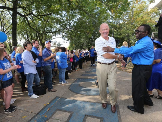 MTSU head football coach Rick Stockstill stops to greet