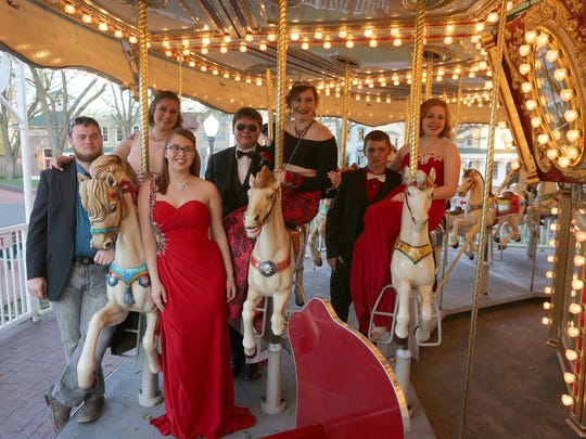 Indianola High School students pose for photo at the Adventureland carousel in 2017. The Indianola prom returns the Adventureland this weekend.