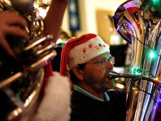Members of the Naples Concert Band perform in the 19th annual TUBA Christmas performance on Thursday, Dec. 18, 2014, in the Sugden Plaza in downtown Naples.
