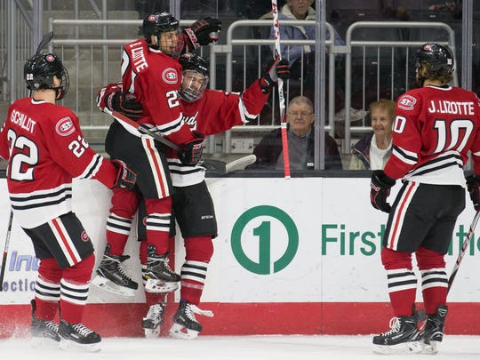 St. Cloud State's Jimmy Schuldt (22), Blake Lizotte,