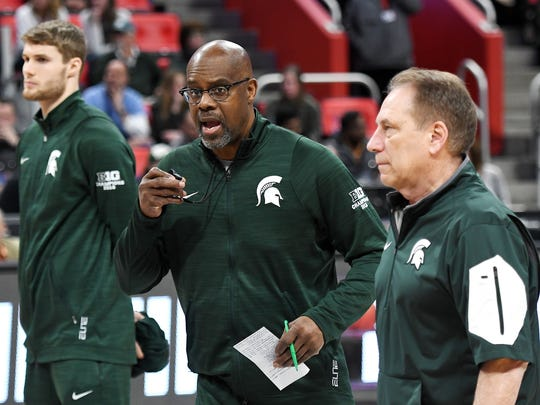 Michigan State's assistant coach Mike Garland, center,