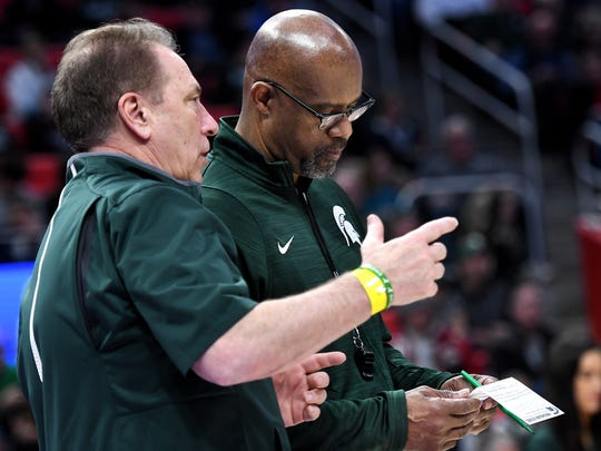 Michigan State's assistant coach Mike Garland, right, and head coach Tom Izzo talk during an open practice on Thursday, March 15, 2018, at the Little Caesars Arena in Detroit.