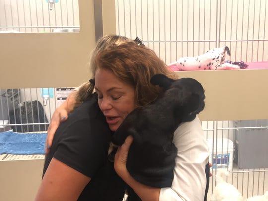 Pet store spokeswoman Linda Nofer hugs Glendale police