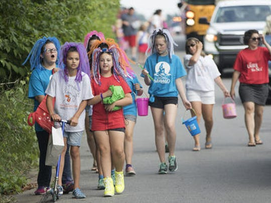 "Mosinee Community Theater's production of ""The Little Mermaid"" participate Monday in Mosinee's Fourth of July parade."